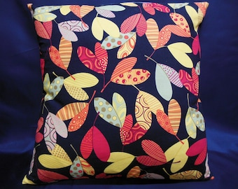 Pillow cover leaves red/orange/yellow/green and blue tones on black background
