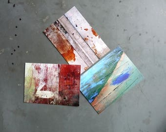 Three postcards with photos, painterly abstract theme