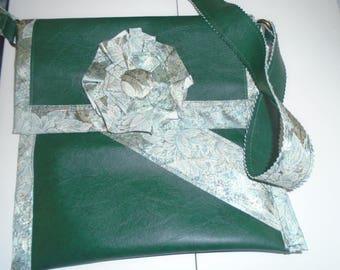 Green leatherette bag worn over the shoulder.