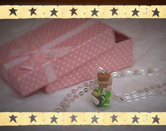 Green, lime green and yellow buttons with her necklace vial