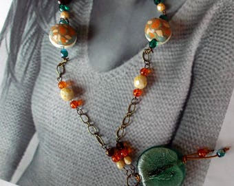 Necklace with polymer clay beads orange, turquoise, caramel and white large flat round disc glass and silver foil