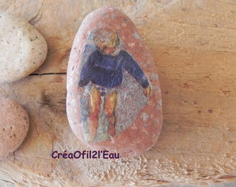 Pebble paperweight: kid on the beach