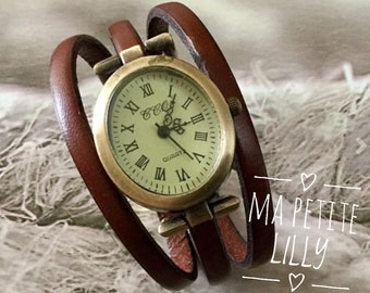 Ladies size watch. S. oval bronze Brown
