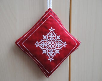 Embroidered fabric hanging red square cushion