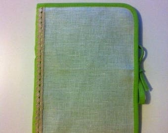Health book has embroidered cross, fabric lined green dot