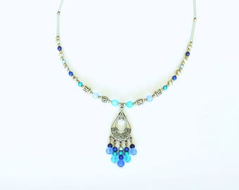 Crew neck collar with variegated blues and chandelier pendant