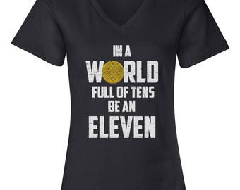 In A World Full Of Tens Be An Eleven Women's Relaxed V Neck Tee T-Shirt-Black