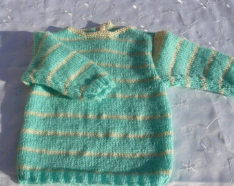 Green and white striped baby sweater