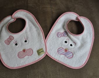 Set of two white rabbit baby bibs