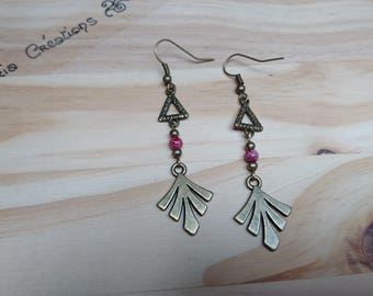 Pair of leaf and red triangle earrings