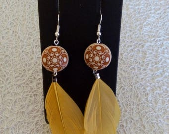 earrings with pearls and feathers
