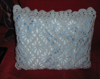 Blue pillow in the hand-made hook