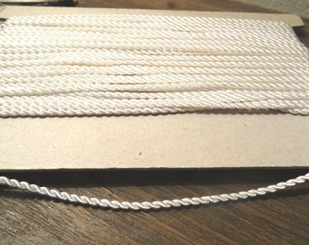 1 m white cotton 2 mm satin cord (looks yellow because of the lamp while taking)