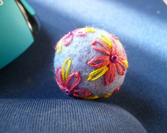 felted wool beads blue light, embroidered in pink and yellow