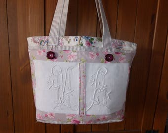 Carrying bag in vintage fabric sheet with monograms, mattress fabric cross trimmed in floral fabric