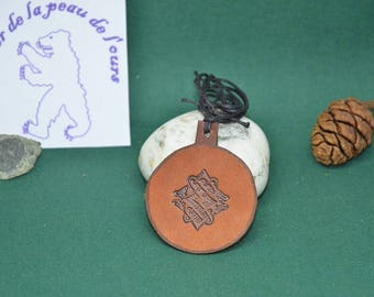 Leather pendant with a design of interlacing Eagle head