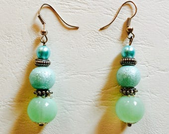 Earrings in shades of green, glass and metal beads