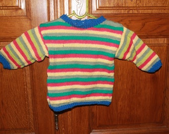 Pullover multicolor striped child's hands