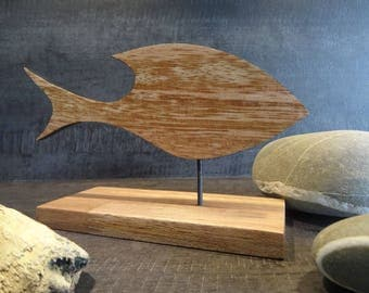 Fish design on the base of exotic wood