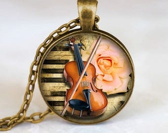 A beautiful necklace with a glass cabochon 25 mm violin music