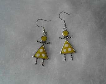 girl yellow and white earrings