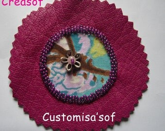 Customisa'sof fuschia and turquoise material for customization