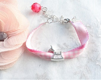 Kit bracelets Pearl, silver and pink girl passing rocking horse