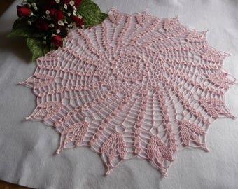 Handmade pastel pink cotton crochet lace doily.