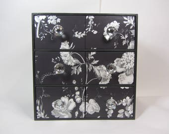 Black and silver wallpapered small chest of drawers