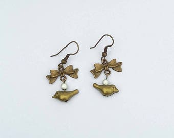 Fancy bird and bow charm earrings