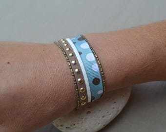 This bracelet with Ribbon and in white and Brown hues