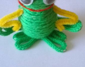 Frog made by knitting wool.