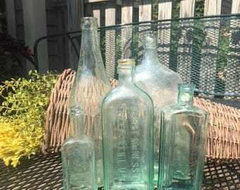 Set of 5 vintage green glass bottles