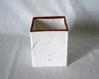 small pot made of cardboard for pencils