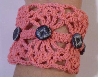 wide bracelet crocheted with upholstery tacks buttons