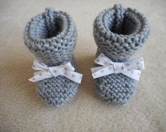 Star grey wool baby booties and Ribbon.