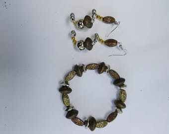 Bracelet and earrings made w/ gold and silver beads