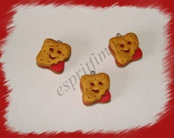 """Smile Strawberry biscuit"" charm in polymer clay"