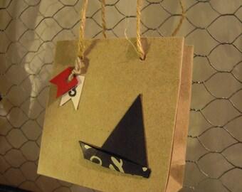 miniature kraft, origami and flags sailboats, nautical bags