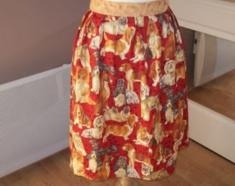 kitchen apron knotted at the waist dogs pattern on red background