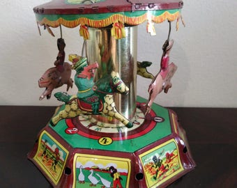 Tin toy-vintage CAROUSEL CAROUSEL with horses year ' 70