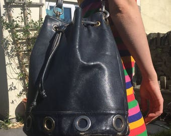 Navy blue leather vintage bucket bag with gold ring detail