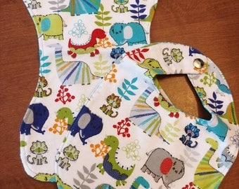 Prehistoric playmates bib and burp cloth set