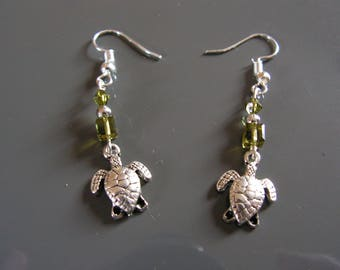 Green glass beads and small turtle earrings