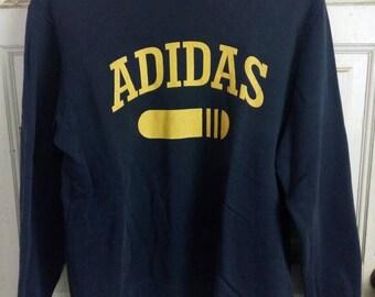 Adidas sweatshirt spell out
