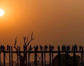 People crossing the U-Bein Bridge near Mandalay, Myanmar