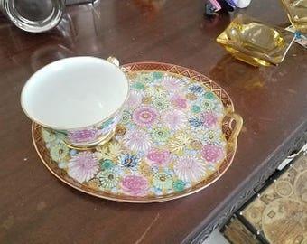 Vintage fine porcelain luncheon plate and  tea cup. Floral design luncheon plate and tea cup, pink flower, gold trim plate