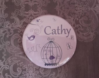 Pocket mirror bird and cage name