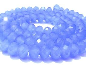 26 perles à facette cristal bleu calcédoine de 6x4 mm.