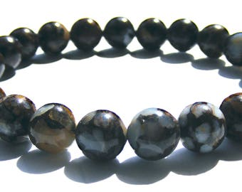 Bracelet jaspe composé de 24 perles de 8 mm marron et blanche et ficelle élactic.